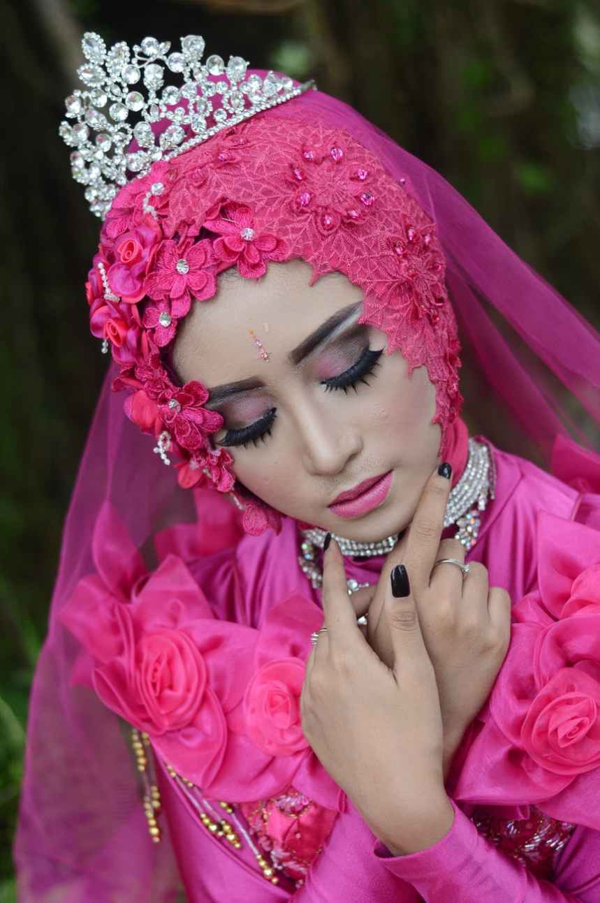 woman in pink traditional dress wearing a tiara